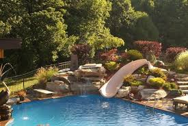 Image Swimming Pool Inground Pool With Water Slide And Rock Waterfall Built In As Well As Pool Slides For Inground Pools Pictures Also Pool Slides For Inground Pools Colorado Pinterest Inground Pool With Water Slide And Rock Waterfall Built In As Well