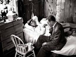 w eugene smith s country doctor re ing a landmark photo dr ceriani sits at bedside of a patient as he assesses flu symptoms during a