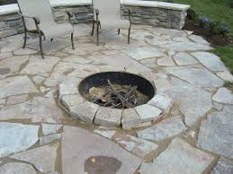 stone patio with raised flagstone firepit
