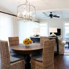 neutral transitional breakfast nook with rattan dining chairs