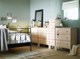 ikea bedroom cabinets.  Ikea A Bedroom With A Large Black Iron Bed Shown Together Solid Pine Chest  Of Drawers With Ikea Bedroom Cabinets O