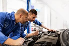 Repairing And Maintenance Auto Service Repair Maintenance And People Concept Mechanic