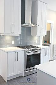 white shaker style cabinets white quartz countertops coventry gray island and stonington gray walls