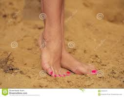 The Girls Feet With A Bright Pedicure And The Tattoo Standing