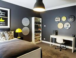 bedroom wall furniture. bedroom teen boy ideas in grey theme with dark wall and brown carpet combined white wooden bed furniture also yellow lamp