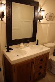 primitive bathroom lighting. decoration witching primitive bathroom light fixtures using wall mounted lanterns beside hammered bronze mirror over integrated lighting h