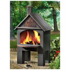 stylish and antique outdoor fireplace with cabin cooking and steel chiminea