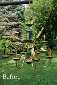 so i took this old ugly green faux marbled and gold outdated chandelier spray painted it with white primer then spray painted it with pink paint