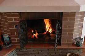 remove dirt soot and debris from your fireplace mantel with routine cleaning