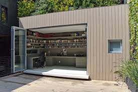 outdoor home office. inspiration for a contemporary built-in desk home office remodel in mexico city with gray outdoor