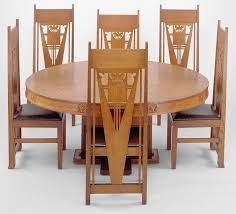 round table with cross shaped centralized base top has 12 wedges around small circle