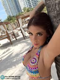 Busty babe Brook Ultra wearing a Bikini in Public 2 of 2
