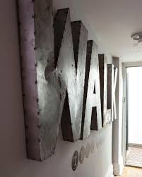 Large Metal Letters on Wall in Neutral Hallway