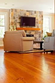 martha mills reclaimed pine floor with a fieldstone veneer fireplace by stonewoods com