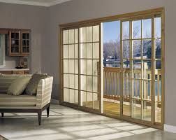 view in gallery four panel sliding glass door in with sqaure grids creates a timeless look