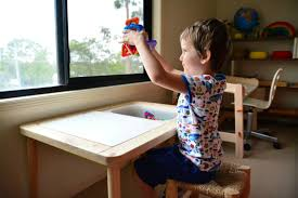 otis using the ikea flisat children s table at how we montessori