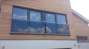wall d juliette balcony with slotted top and bottom rails tinted glass infills