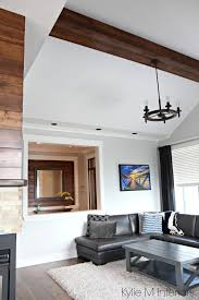 living room design with vaulted ceiling faux wood beam chandelier benjamin moore gray owl paint colours design by kylie m interiors e decor