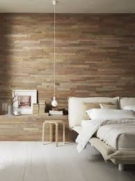 a modern bedroom is made cozier and more welcoming with a reclaimed wooden wall whitewashed