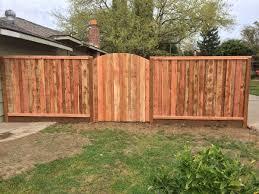 board on board fence w arched gate