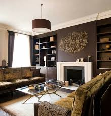 living room design ideas brown accent wall fireplace built in shelves beige and brown living room