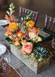 Flower boxes: Try this unexpected take on a centerpiece: Plant your stems  in aged, wood boxes. A mix of blooms and heights give this arrangement a  relaxed, ...