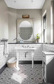get the look the floor and wall tiles are by topps tiles the basin is by fired earth the brassware is by aston matthews the wall light is a vintage