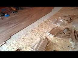 installing hardwood floor with glue on osb panels 3 hours of work in 2 minute time lapse
