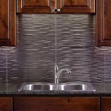 fasade 24 in x 18 in waves pvc decorative tile backsplash in brushed nickel