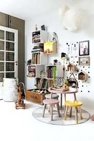 scandanavian area rug playroom bookshelves with kids pretend play toys and backless gray area rug scandinavian style area rugs