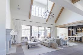 two living room with tiered iron candelabra chandelier