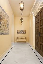 Mediterranean Entryway with simple marble floors, Marrakech Frosted  Lantern, Pendant Light, Bianco Venatino
