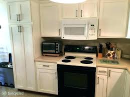 revere pewter kitchen cabinets gold hardware white fish scale tile design inspiration by with walls