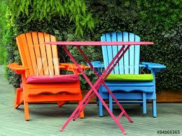 brightly painted garden furniture stock