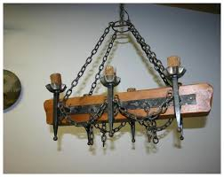 an old french wooden wrought iron castle chandelier
