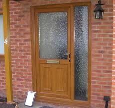 front door and full height narrow side panel all in light oak upvc
