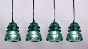 sold industrial pendant lights made from antique glass insulators chrome fittings