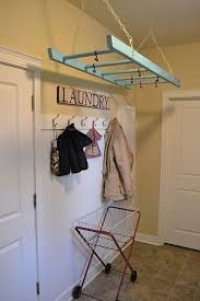 Wooden ladder used as a laundry drying rack... we love this idea!