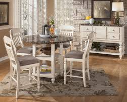 impressive white kitchen table and chairs 13 round wooden with flower brown carpet standing lamp at room corner cabinet on grey wall painted