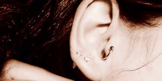 Does A Tragus Piercing Hurt What To Know About Pain Cost And Healing