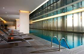 swimming poolmodern decorating design indoor swimming pool ideas with long pool also grey tiled amazing indoor pool lighting