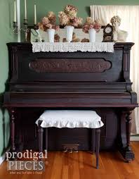 ornate antique upright grand piano with linen upholstered piano bench by larissa of prodigal pieces