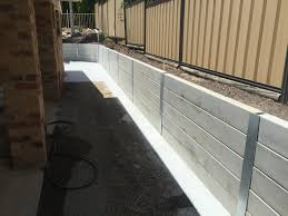 the result brand new concrete sleeper retaining wall