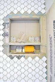 during a bathroom bath remodel renovation built in shower shelves installing tile recessed shelf