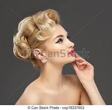 beautiful young with jewels makeup in sixties style arrow gray background hairstyle