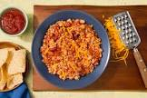brown rice and beans with cheese and chilies