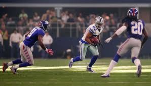 terrance williams of the dallas cowboys carries the ball against kelvin sheppard 91 of