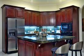 dark cabinets small kitchen a small eat in kitchen with rich cherry wood cabinets and stainless