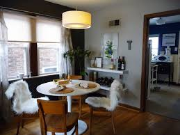 minimalist overwhelming dining room light fixtures. breathtaking dining room with white pedestal table in round design furnished wooden chairs and soft minimalist overwhelming light fixtures i