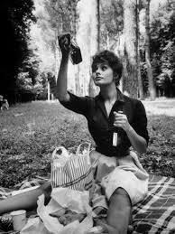 Actress Sophia Loren Examining Contents of Bottle During Location ...